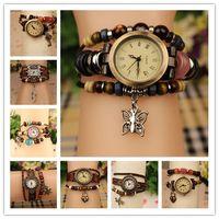 pulseira de pingente de borboleta relógios venda por atacado-Venda quente Pulseiras De Couro Genuíno Relógios Das Mulheres de Quartzo Relógios De Pulso Pingentes Folha Da Borboleta Do Coração Da Libélula Mix Designs 100 pcs