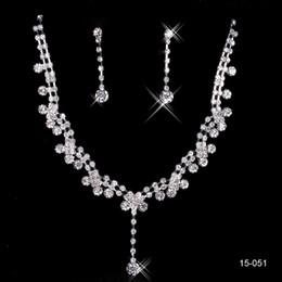 Pendientes de clip de collar online-2019 Conjuntos para mujer nupcial barato Desfile de boda Pendientes de collar de diamantes de imitación Conjuntos de joyas para joyería nupcial de fiesta