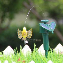 Wholesale Solar Flying Fluttering Hummingbirds - 2014 new dynamic Solar hummingbirds Flying Fluttering Birds Flying Butterflies Patio Lawn Garden Decorations romantic Kids Toy A176H