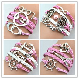 Wholesale Wholesale Pink Leather Charm Bracelet - Infinity Bracelets Antique Charm Love Butterfly Eiffel Tower Anchor Pink Color Mix Designs Leather Bracelets Fashion Jewelry Free Shipping