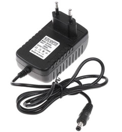Wholesale Adapter Uk 2a 12v - DHL Freeshipping AC 100V-240V to DC 12V 2A 5.5mm x 2.5mm Plug Converter Wall Charger Power Supply Adapter EU US UK plug MQ50