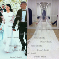 2014 Kim Kardashian And Kanye West Wedding Mermaid Appliques Sheer Waist Long Illusion Sleeve Court Train Bridal Dress Dhyz 01
