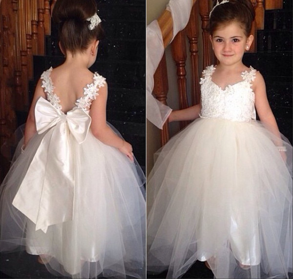 top popular Lovely Flower Girls Dresses For Weddings V Neck Tulle Floor Length Backless Ball Gown Junior Bridesmaid Dresses For Girls Real Image 2019