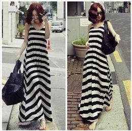 d0dd372623bc Fashion Women Long Maxi Dresses Loose Ladies Skirt Bohemian New Summer Dress  Black and White Stripe Sexy Dress Girls Casual Party Dress YQ37