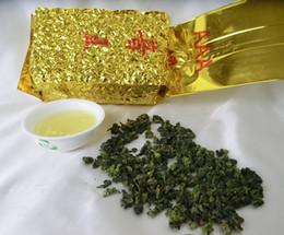 Corbata de te online-250 g de calidad superior Anxi Tieguanyin té, Oolong, té Tie Guan Yin, té de cuidado de la salud, envasado al vacío, envío gratis
