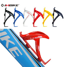 Wholesale Black Red White Bottle Cage - SKU768 INBIKE plastic steel Bike rack kettle . black, blue, white, red, yellow (please select the color you need. Otherwise send random)