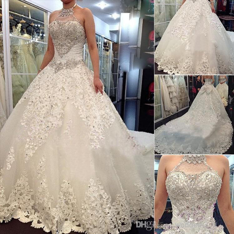 Newest Luxury Wedding Dresses 2019 With Halter Swarovski Crystals Beads Backless A Line Chapel Train Lace Bling Customed Ivory Bridal Gowns