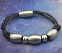 Pulseras de pulsera de cuerda de cuero negro de acero inoxidable de alta calidad de buena calidad con cierre magnético de tono de acero y tubo ovalado desde fabricantes