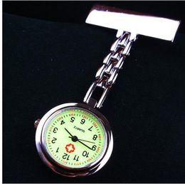 El envío libre 10pcs / lot Los pernos de las enfermeras de los doctores miran la enfermera del cuarzo del acero inoxidable, conveniente llevar los relojes Luminous nurse watch gift desde fabricantes