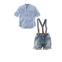 Argentina Venta al por menor de nuevos bebés varones rayas casuales camiseta Top + Blue Strap Jeans 2 piezas Set niños Gentleman Suspender trajes para niños guapo conjunto de ropa Suministro