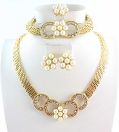 Gli insiemi unici estetici romantici dei monili della festa nuziale del Rhinestone di disegno dell'anello del braccialetto della perla del fiore della perla della collana liberano il trasporto in Offerta