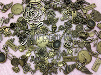 Wholesale Butterfly Findings - 200pcs Assorted Size Antiqued Bronze Rose Gun Flower Skull Butterfly Cat Charms and Pendants Tibetan Style Jewelry Finding