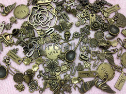 Wholesale Skull Findings - 200pcs Assorted Size Antiqued Bronze Rose Gun Flower Skull Butterfly Cat Charms and Pendants Tibetan Style Jewelry Finding