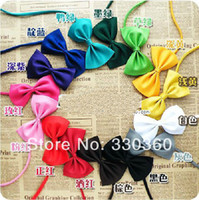 Atacado-Hot New 50pcs / lot MultiColor cão gravata Doggy Bow Tie Pet Grooming mantilha Bowtie Gravata Pet Fornecedor