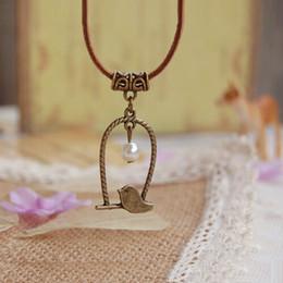 2014 Акции Новая Мода Винтаж Металл Birdcage Bird Pearl Подвеска Кожаная цепь Ожерелье Заявление ювелирные изделия для женщин PT33 от