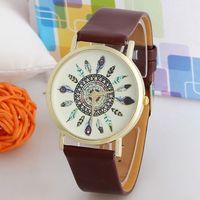 перьевые часы оптовых-Wholesale-1 Piece Fashion Women Vintage Feather Dial Leather Band Quartz Analog Unique Lady Wrist Watch T-east
