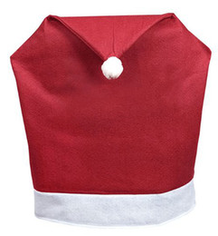 $enCountryForm.capitalKeyWord UK - Pack of 4 Soft Red and White Fabric Santa Hat Christmas Chair Slip Covers