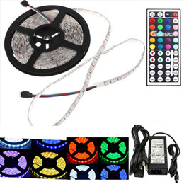 Wholesale Rgb Led Controller Power Supply - Waterproof IP65 5M 300 Leds SMD 5050 RGB lights led strips 60 leds M + 44key remote controller + 12V 5A power supply