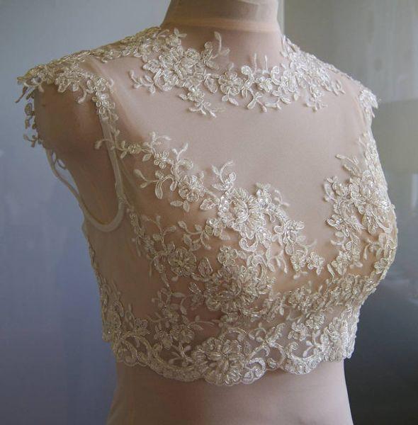 best selling 2016 Delicate Lace Bridal Jackets Jewel Neck Cap Sleeves Illusion Appliques Tulle White Ivory Champagne Bridal Shrugs Bolero Wrap