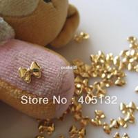 Wholesale Black 3d Bows Nails - MD-578 3D 50pcs bag Nail Decoration Metal Gold Bow Metal Nail Art Decoration