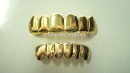 Гриль золото онлайн-Wholesale-REAL SHINY!! REAL GOLD PLATED HIPHOP TEETH GRILLZ TOP & BOTTOM GRILL SET