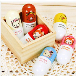 Wholesale Christmas Ball Pens - Wholesale-1PC SEND RANDOM Cartoon ball-point pen stationery primary children stationery students prize christmas gift pill shape CB057