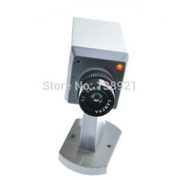 Caméras de sécurité factices en gros en Ligne-Détecteur de détection de mouvement de caméra de sécurité fictif à la recherche de sécurité réaliste