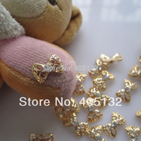Wholesale Nails Metal 3d - Wholesale-MD-603 3D 50pcs bag Gold Bow Nail Decoration Metal Shinny Deco Metal Nail Art Decoration