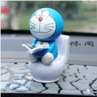 Wholesale Shake Dolls - Wholesale-Auto Car Interior Decoration Solar Energy Four Facial Expressions Funny Head Shaking Doraemon Reading Books on Toilet Dolls Toys