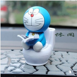 Wholesale Toilet Toys - Wholesale-Auto Car Interior Decoration Solar Energy Four Facial Expressions Funny Head Shaking Doraemon Reading Books on Toilet Dolls Toys