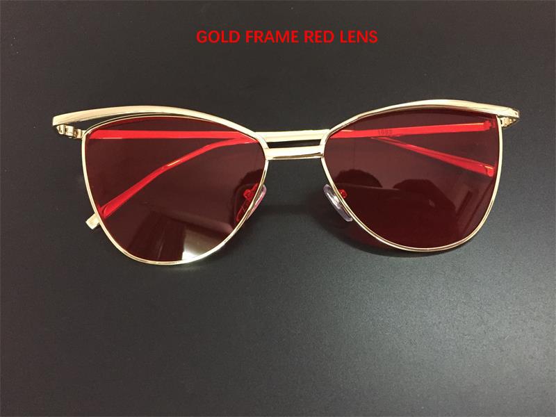 lente roja marco de oro