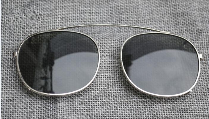 Tamanho da lente verde moldura prateada S