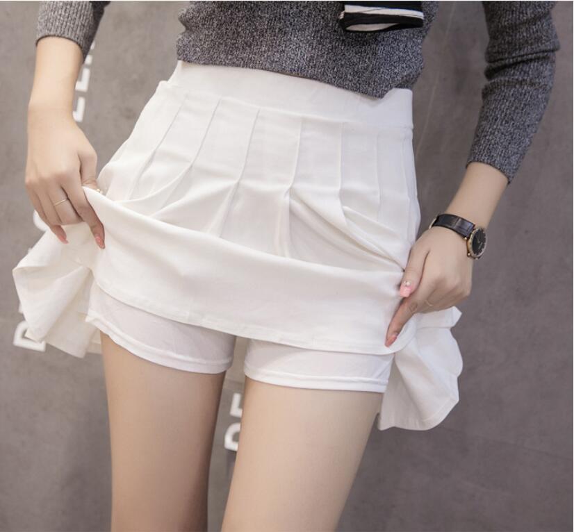 Les femmes de haute taille Jupes plissées Vêtements pour femmes douces filles mignonnes danse Mini jupe cosplay jupe noir blanc Femme Mini Kawaii Jupes courtes