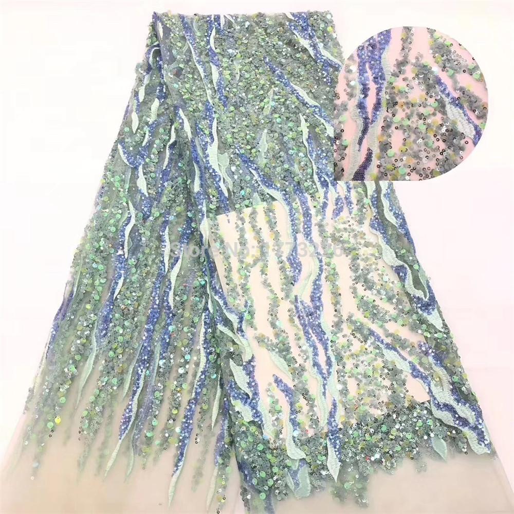 La última tela de encaje africana tela de encaje neta de alta calidad con lentejuelas multicolores tela de secuencia de encaje de malla francesa para vestido de noche