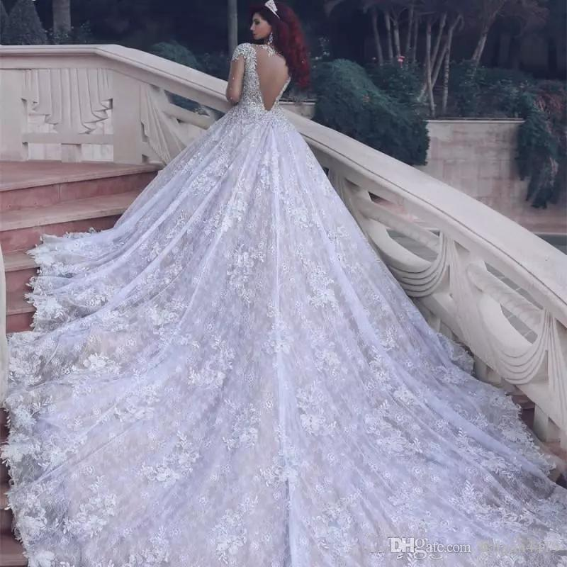 2018 New Arabic A Line Wedding Dresses Jewel Neck Long Sleeves Full Lace Appliques Crystal Sheer Back Plus Size Chapel Train Bridal Gowns
