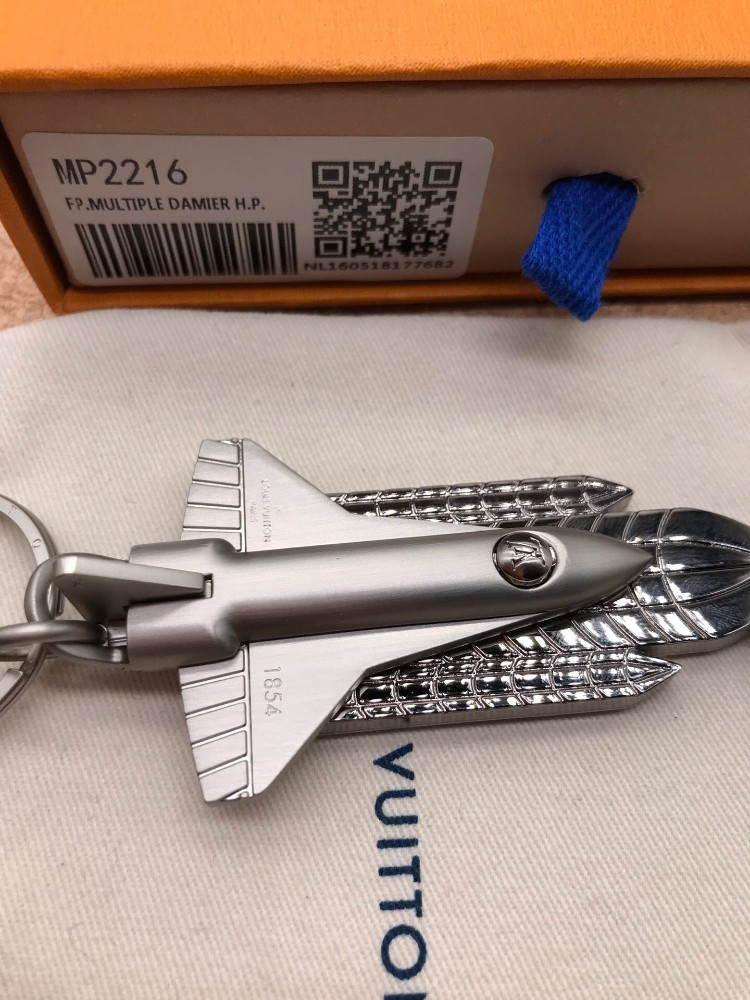 Space shuttle styling, combining two key chains into one, one by the driver and one for the berth