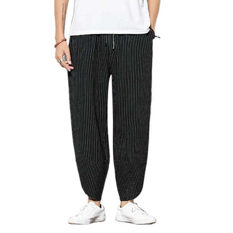 Pantalones de tela a rayas negro-azul
