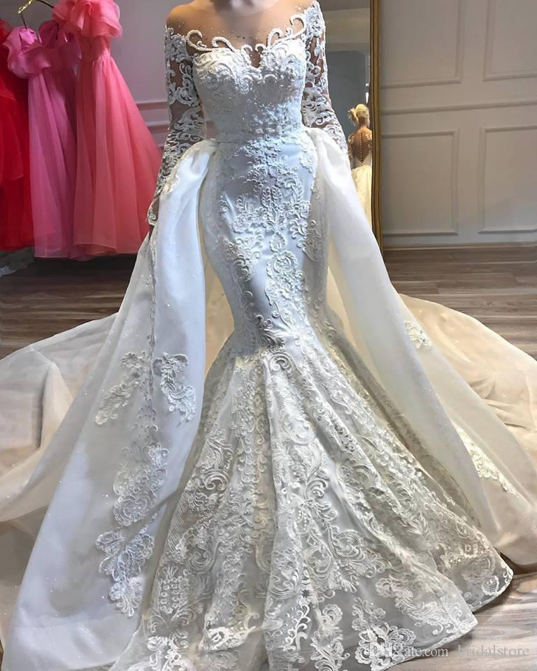 Luxury Arabic Dubai Mermaid Wedding Dresses With Detachable Overskirts Sheer Neck Beaded Long Sleeve Bling Long Train Lace Bridal Gowns 2019