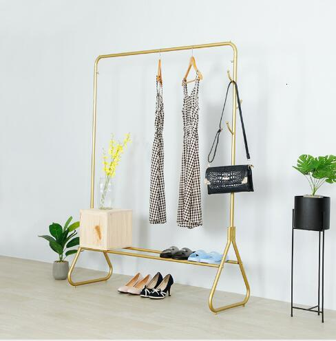 Golden display rack Iron boutique clothing store showcase floor-mounted Tieyi front and side hanging clothes display rack gold
