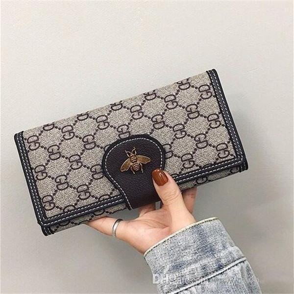 Factory wholesale women bag retro woven long wallet personalized hollowed out brand wallets fashion Embossed Leather Womens handbag