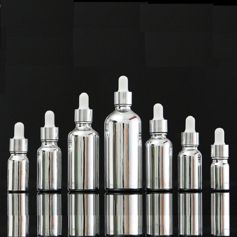 silver glass essential oil bottles