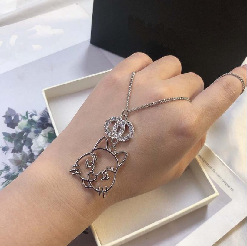 Xiaoxiangfeng new Xiaoxiang cat S925 silver needle necklace earrings are versatile