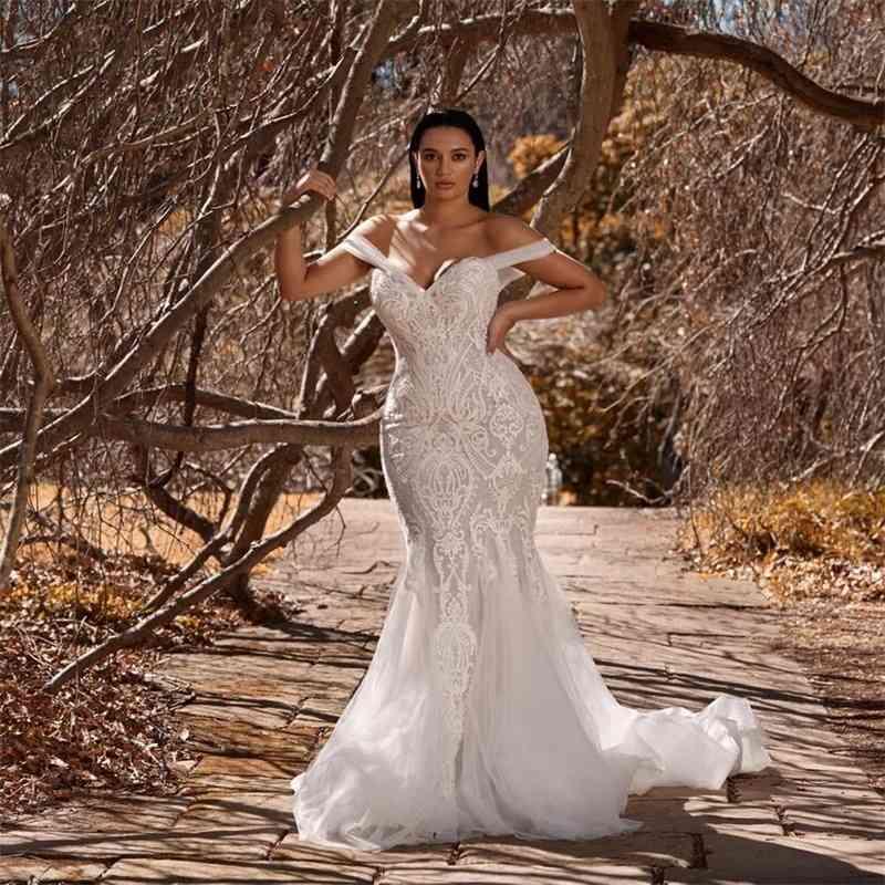 Sexy Mermaid Wedding Dresses Spaghetti Strap Sleeveless Appliqued Lace Boho Bridal Dress Backless Sweep Train Bridal Gown Vestidos De Novia