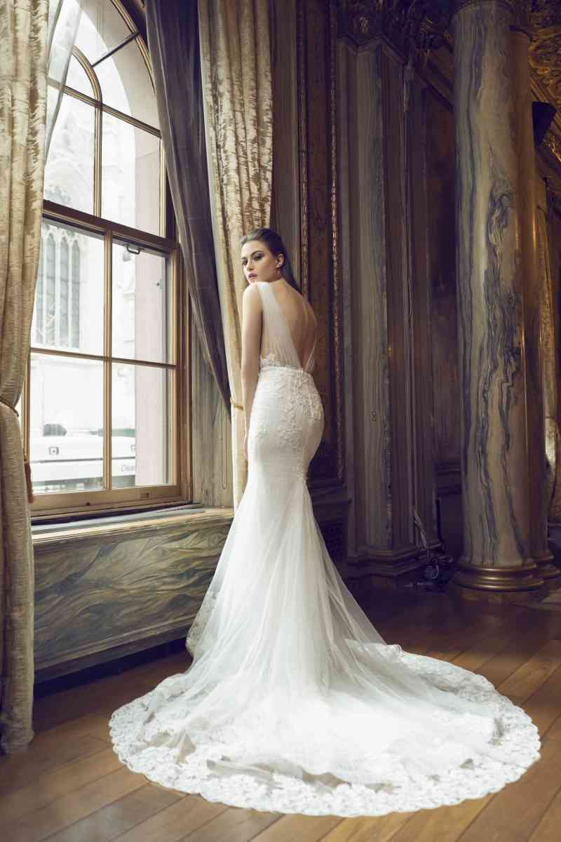 Sexy Backless Mermaid Wedding Dresses V-neck Sleeveless Appliqued Lace Cheap Bridal Gown Sweep Train Custom Made Robes De Mariée Hot Sell