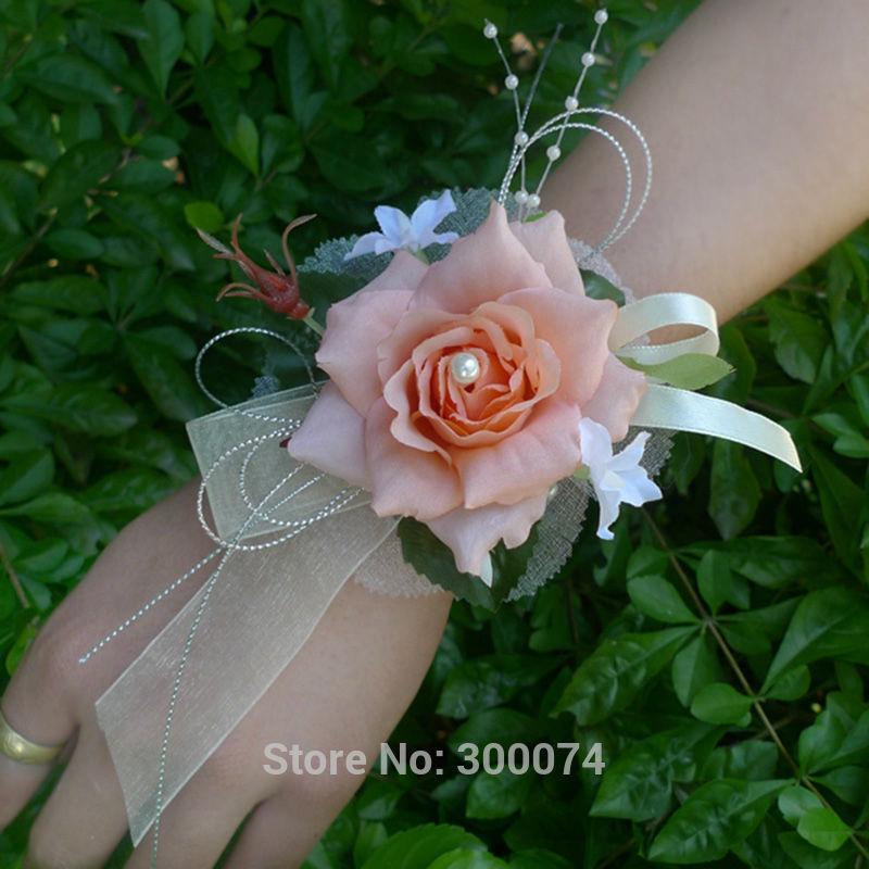 Orange wedding flower corsage for bride