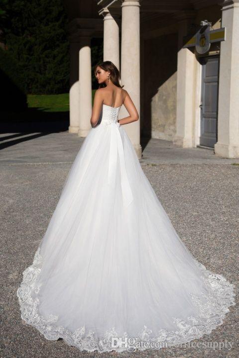 Luxury Dubai Sleeveless Beaded Sash Wedding Dresses 2018 Sweetheart Lace Appliques Lace-up Bridal Gowns Sweep Train Saudi Arabia Vestidos