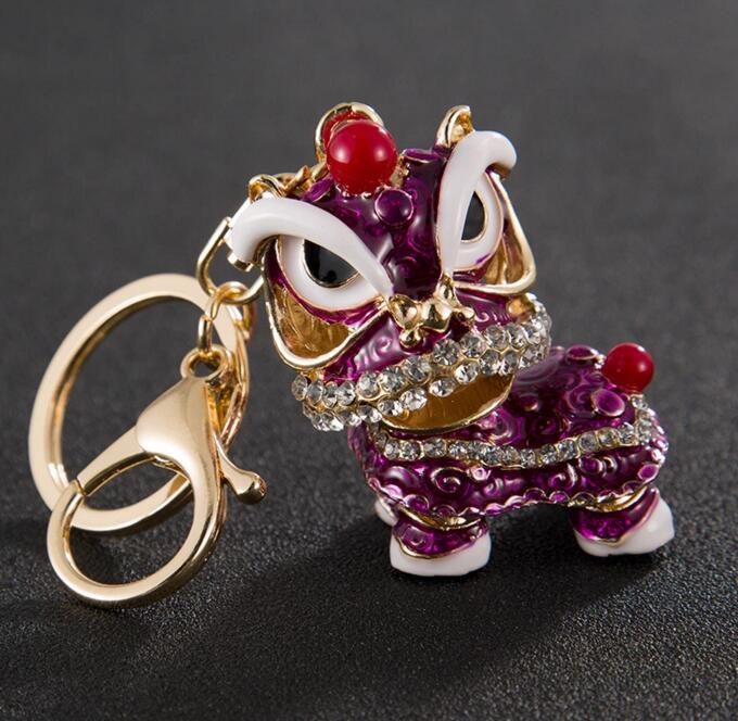 Creative small gift metal keychain accessories Chinese style lion dance Kirin alloy key chain fashion girls car pendant small toys wholesale