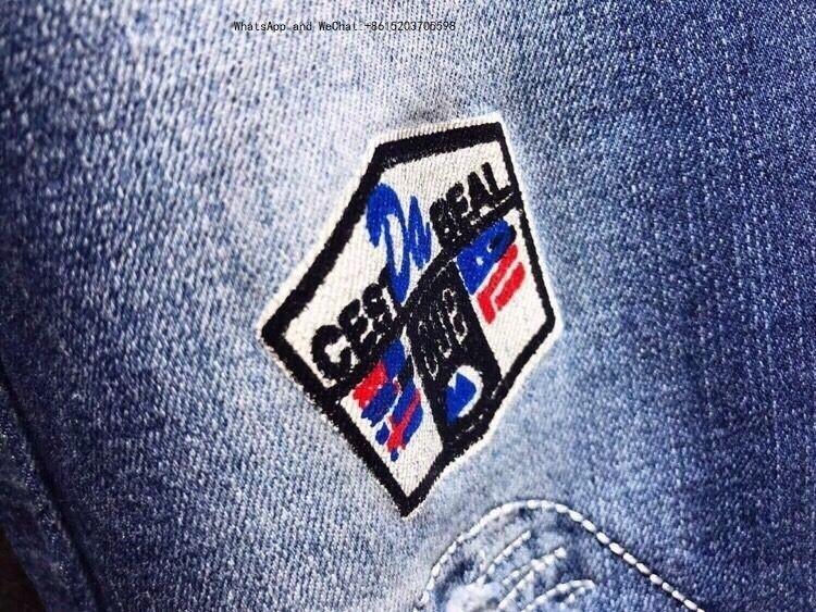 J8 High Street Tide Man noir et blanc connexion Jeans Slim petits pieds adolescents Pantalons