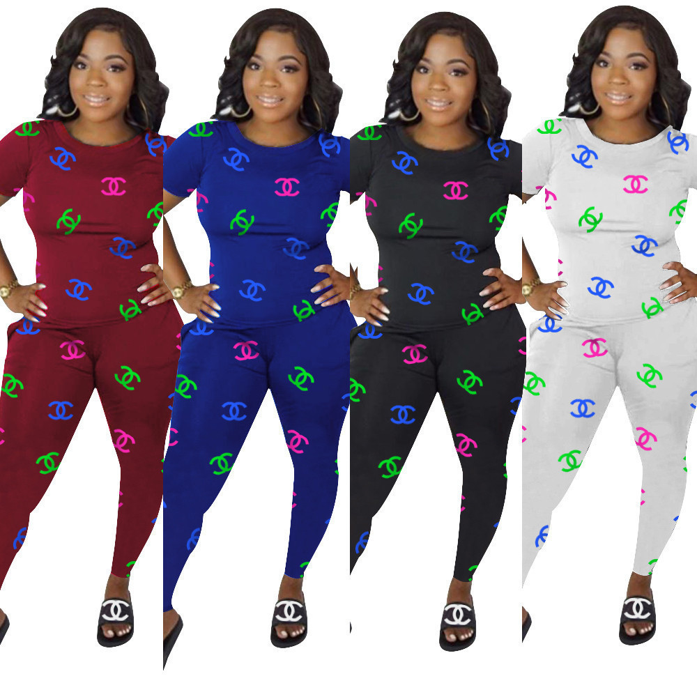 Woman 2 piece track suit short sleeve and pant leggings US Large