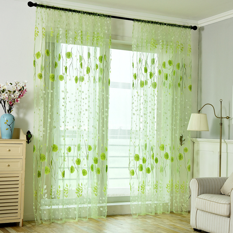 The balcony completes printed floral curtains, living room, kitchen windows, and beautiful sheer curtains in the bedroom windows.